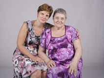 Portrait of the eighty years of the mother and fifty daughters Stock Image