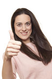 Portrait einer glücklichen jungen Dame, die sich einen Daumen zeigt Lizenzfreies Stockbild