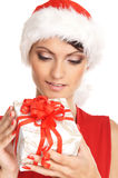 Portrait einer jungen Frau in einem Weihnachtshut Stockfotos