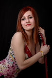 Portrait einer schönen Jugendlichen mit Gitarre Stockbild