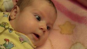 Portrait eines überraschten Babys 4K UltraHD, UHD stock video