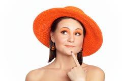 Portrait eines denkenden Mädchens in einem Hut Lizenzfreies Stockbild