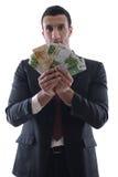 Portrait eines Geschäftsmannholding und -fang falli Lizenzfreie Stockfotos
