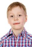 Portrait eines Jungen in einem Plaidhemd Stockfoto
