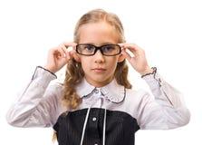 Portrait eines jungen schönen Mädchens in den Gläsern Lizenzfreie Stockfotografie