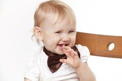 Portrait eines Kindes auf einem weißen Hintergrund Stockbild