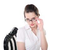 Portrait eines Mädchens in den Gläsern Stockbild