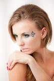 Portrait eines Mädchens mit bunten Augen Lizenzfreies Stockfoto