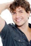 Portrait eines reizvollen Mannes mit toothy Lächeln Stockbilder