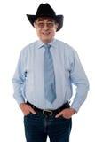 Portrait eines tragenden Hutes des älteren Cowboys lizenzfreie stockbilder