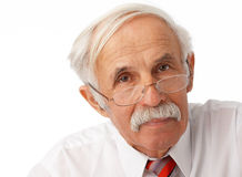 Portrait of an elder man. Close-up portrait of an elder man loking at you Stock Photography