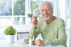 Portrait of an elder man making inhalation royalty free stock photography