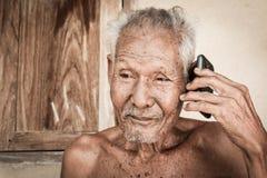 Portrait of elder man use telephone Royalty Free Stock Image