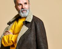 Portrait of elder stylish rich man with a beard and mustache in a leather winter coat stock photo