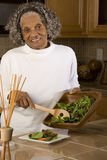 Portrait of an elderly African American woman at home. Happy elderly African American woman at her house Royalty Free Stock Photo