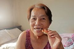 Portrait of elderly asian woman are smiling see broken tooth stock images