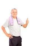 Portrait of an elderly athlete giving a thumb up Royalty Free Stock Photography