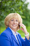 Portrait of an elderly beautiful woman talking on a cell phone Stock Photo