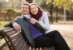 Portrait of elderly boyfriend and girlfriend. Portrait of Mature boyfriend and girlfriend in autumn day stock images