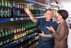 Portrait of an elderly couple buying a beer royalty free stock photography