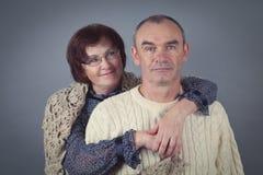 Portrait of elderly couple, studio Royalty Free Stock Image