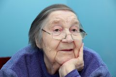 Portrait of an elderly grandmother in glasses Stock Photos