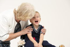 Portrait of an elderly grandmother and young grandson Royalty Free Stock Image