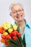 Portrait of elderly lady with flowers Royalty Free Stock Photos