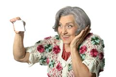 Portrait of elderly lady holding mobile phone Stock Images