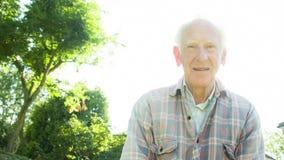 Portrait of an elderly male gardener stock video
