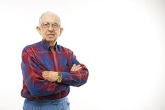 Portrait of elderly man. Portrait of Caucasion elderly man wearing plaid shirt and cowboy hat with arms crossed Stock Images