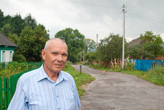 Portrait of elderly man. Portrait of an elderly man on the background of the rural landscape Stock Photos