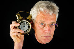 Portrait of elderly man with clock Royalty Free Stock Photo