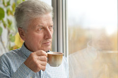 Portrait of an elderly man drinking Stock Photo