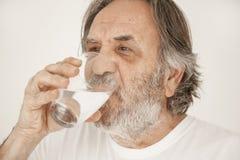 Portrait elderly man drinking water stock image
