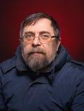 Portrait of elderly man in glasses Stock Images