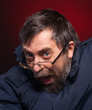 Portrait of elderly man in glasses Stock Photo