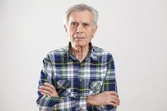 Portrait elderly man on gray background Royalty Free Stock Photography