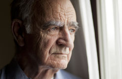 Senior Man Looking At The Window royalty free stock photo