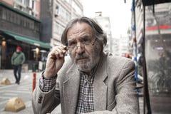 Portrait elderly man in outdoors stock photography
