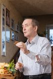 Elderly man pronouncing a toast. Portrait of an elderly man pronouncing a toast Royalty Free Stock Photography