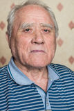 Portrait of elderly man. In a striped shirt Royalty Free Stock Images
