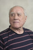 Portrait of elderly man. In a striped shirt Stock Image