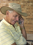 Portrait of Elderly Man Talking on Cell Phone. Royalty Free Stock Photo