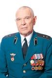 Portrait of elderly man in uniform. On a white background Stock Photo