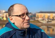 Portrait of elderly man wearing glasses Stock Images