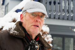 Portrait elderly man in winter Stock Images