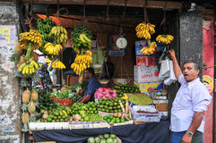 Portrait of elderly market vendor Stock Images