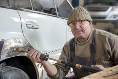 Portrait of an elderly mechanic Royalty Free Stock Image