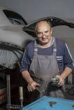 Portrait of an elderly mechanic Royalty Free Stock Photos